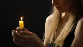 Peaceful smiling lady holding burning candle hoping for better, faith and belief. Stock footage stock footage