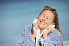 Peaceful smiling woman closed eyes outdoor Stock Image