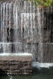 Peaceful sounds of waterfall tumbling over cut stone Stock Images