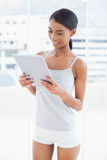 Peaceful sporty model holding tablet computer Royalty Free Stock Photo