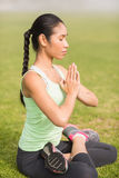 Peaceful sporty woman doing the lotus pose Royalty Free Stock Photography