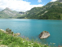 Peaceful spot by the lake. Peaceful spot by a lake in the french Alps Stock Photography