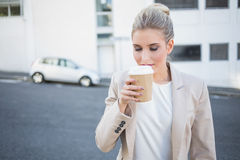 Peaceful stylish businesswoman smelling coffee Royalty Free Stock Images