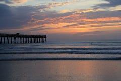 Peaceful sunrise near the fishing pier Stock Photo