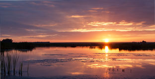 Peaceful sunrise over a dam Royalty Free Stock Images