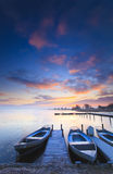 Peaceful Sunrise With Dramatic Sky And Boats And A Royalty Free Stock Photos