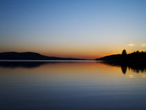 Peaceful Sunset. A beautiful sunset over calm peaceful lake Stock Photos