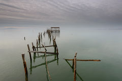 Peaceful sunset in the Carrasqueira pier. Royalty Free Stock Photo