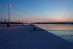Peaceful sunset at the jetty Royalty Free Stock Images