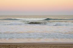 Peaceful sunset with pastel colours and empty beach blur Royalty Free Stock Photos