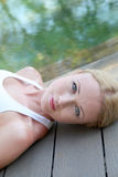 Peaceful time. Portrait of woman relaxing on pool deck Stock Image