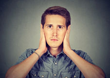 Peaceful tranquil relaxed man covering ears, observing Royalty Free Stock Photos