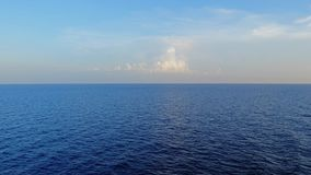 Peaceful View of the Horizon and Open Ocean. 8836 A peaceful view of the horizon over the open ocean. Shot at 48fps stock footage