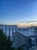 Peaceful view of Paris rooftops just after sunset Royalty Free Stock Images