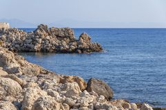 Peaceful view of sea stone rocky coast beach with blue sea Royalty Free Stock Photo