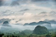 Peaceful view of Vinales valley at sunrise. Aerial View of the Vinales Valley in Cuba. Morning twilight and fog. Fog at dawn in th Stock Photo