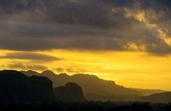 Peaceful view of Vinales valley at sunrise. Aerial View of the Vinales Valley in Cuba. Morning twilight and fog. Fog at dawn in th. E Valley of Vinales in Pinar Royalty Free Stock Images
