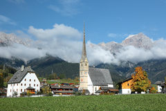 A peaceful village and a church by Hochkoenig Mountains in Austria ~ Royalty Free Stock Photography