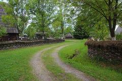 Peaceful Village Road in Romania Stock Photo