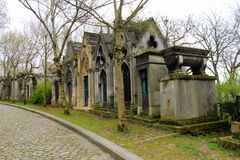 Peaceful walk through cobblestone pathways and tombstones,Pere LaChaise,Paris,France,2016 Royalty Free Stock Photo