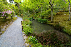 Peaceful walking path in a beautifully landscaped Japanese pond garden Stock Image