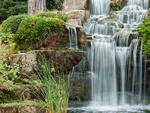 Peaceful waterfall. Beautiful water cascade at London's Kew Gardens Royalty Free Stock Image