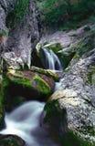 PEACEFUL WATERFALL. Beautiful multi-layered waterfall between vegetation and rocks Royalty Free Stock Photography