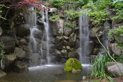 Peaceful Waterfall Scene. Peaceful waterfall over rocks in the woods Stock Photos