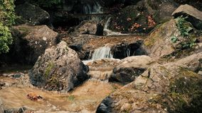 Peaceful waters of a babbling brook flow amongst boulders. UltraHD 4k. Footage stock footage
