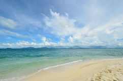 Peaceful white sand beach at Talu island Stock Photos