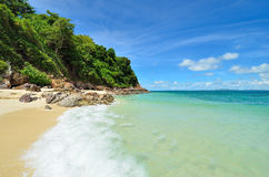 Peaceful white sand beach at Talu island Stock Photo