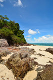 Peaceful white sand beach at Talu island Royalty Free Stock Photos