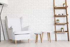 Peaceful whiteness of comfy lounge corner Royalty Free Stock Images