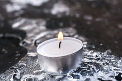 Peaceful Winter Tea Light On Cracked Ice Above A Frozen Table Royalty Free Stock Photo