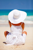 Peaceful woman at the beach Stock Image