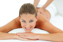 Peaceful woman enjoying a massage Royalty Free Stock Images