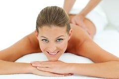 Peaceful woman enjoying a massage Royalty Free Stock Images
