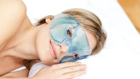 Peaceful woman with an eye gel mask Royalty Free Stock Photos