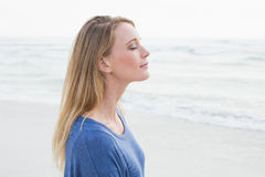 Peaceful woman with eyes closed at beach Stock Photography