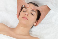 Peaceful woman getting a massage Royalty Free Stock Image