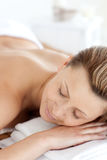 Peaceful woman having a spa treatment. In a spa centre Stock Photo
