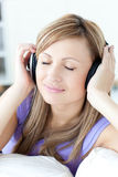 Peaceful woman listening music Stock Photos