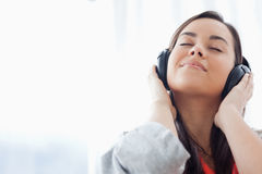 A peaceful woman listening to music on her headphones Royalty Free Stock Photography