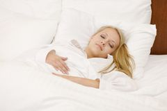 Peaceful Woman Lying in Bed Resting at Home Royalty Free Stock Photos