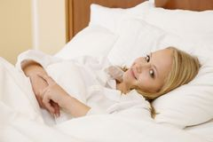 Peaceful Woman Lying in Bed Resting at Home Royalty Free Stock Images