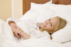 Peaceful Woman Lying in Bed Resting at Home Stock Image