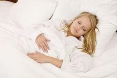Peaceful Woman Lying in Bed Resting at Home Stock Photo