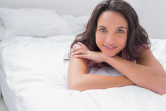 Peaceful woman lying on her bed Stock Images
