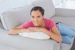 Peaceful woman lying on the sofa Royalty Free Stock Image