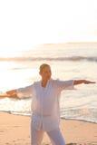 Peaceful woman practicing yoga Stock Photo
